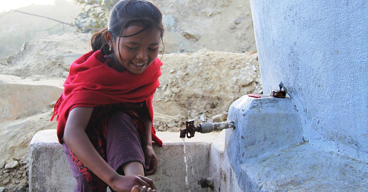 Kalpan washing at her water tap